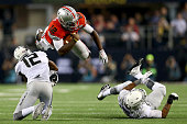 Qarterback Cardale Jones of the Ohio State Buckeyes dives through the air in the third quarter against the Oregon Ducks during the College Football...