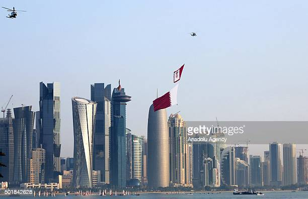 Qatar Air Forces unfurl the flag of Qatar during the 137th anniversary celebrations of the Qatar's National Day in Doha Qatar on December 18 2015...