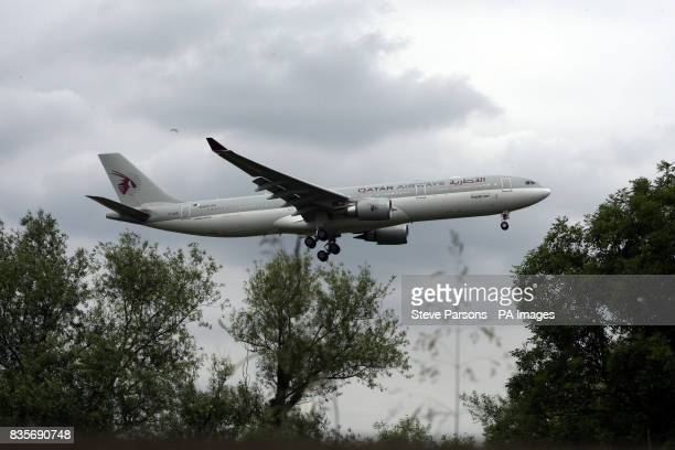 A Qatar Airline Airbus A330 plane lands at Heathrow Airport in Middlesex