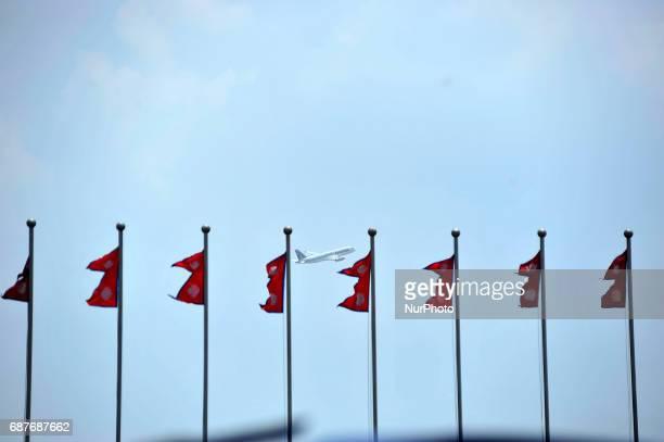 Qatar airplane passes as National Flag of Nepal waving seen from Kathmandu Nepal on Wednesday May 24 2017