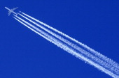 A Qatar Airways Airbus A 340 airplane leaves contrails in the clear sky of Altenmarkt Zauchensee on January 11 2014 AFP PHOTO / ALEXANDER KLEIN