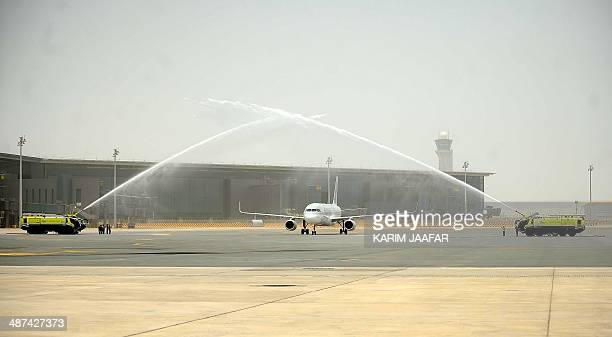 A Qatar Airways aircraft being the first commercial flight welcomed at new Hamad International Airport is greeted by water cannons as it lands on...