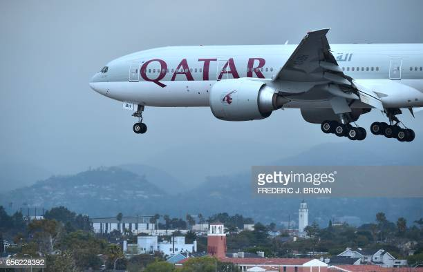 A Qatar Airways aircraft flight 739 from Doha comes in for a landing at Los Angeles International Airport on March 21 2017 in Los Angeles California...