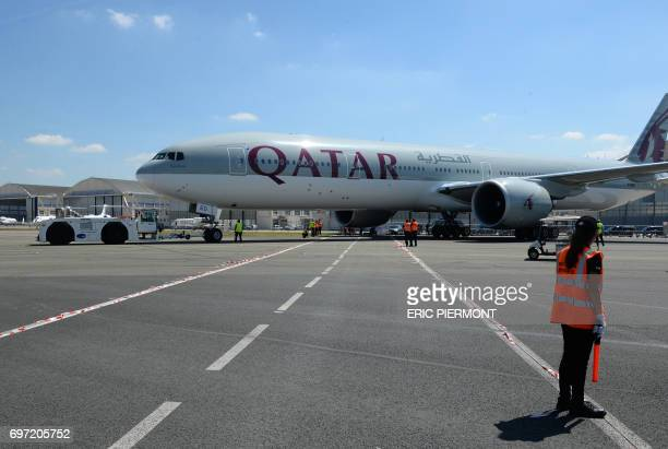 A Qatar Airways Boeing 777300 is moved on the Tarmac of Le Bourget airport on June 18 2017 on the eve of the opening of the International Paris Air...
