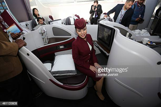 A Qatar Airways flight stewardes poses for a photo on a new Airbus A350XWB at the Doha international airport in Doha on January 72015 Qatar Airways...