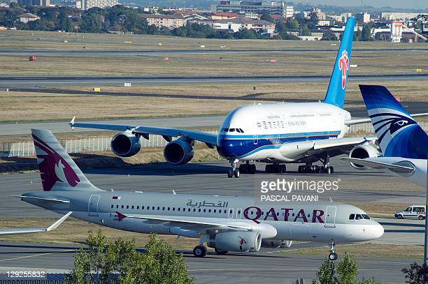 A Qatar Airways plane and a China Southern Airlines' new Airbus A380 are pictured on the tarmac at the ToulouseBlagnac airport in Blagnac...