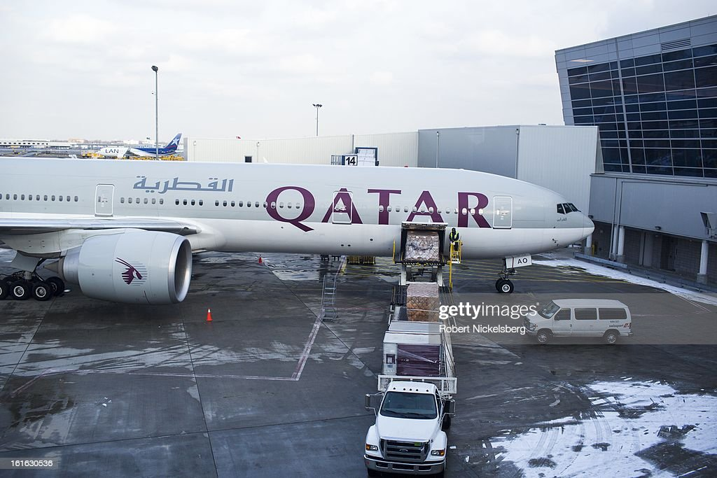 A Qatar Airways plane loads a pallet of cargo February 3, 2013 at the John F Kennedy International Airport in the Queens borough of New York.