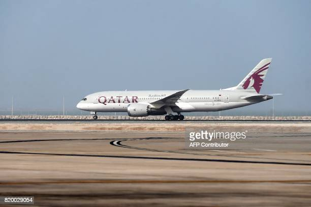 A Qatar Airways plane takesoff from the Hamad International Airport in Doha on July 20 2017 / AFP PHOTO / STRINGER