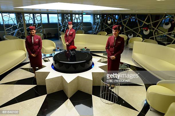 Qatar Airways stewardesses pose in the Qatar Airways Paris premium lounge on the day of its opening at Paris Roissy airport on January 12 2017 / AFP...