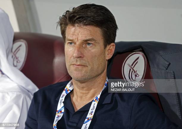 Qatar AlRayyan SC's Danish manager Michael Laudrup looks on during their AFC Champions League group D football match against UAE AlWahda FC at...