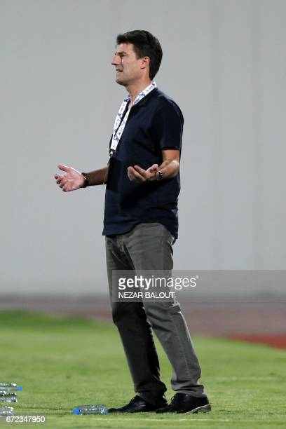 Qatar AlRayyan SC's Danish manager Michael Laudrup reacts during their AFC Champions League group D football match against UAE AlWahda FC at AlNahyan...