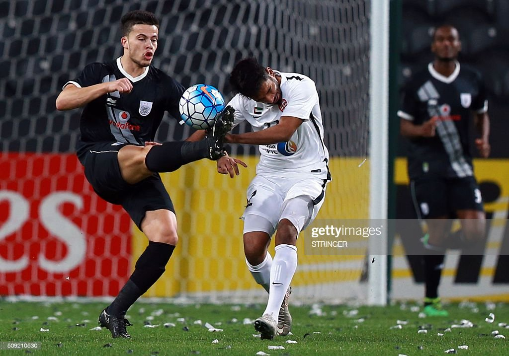 Qatar Al-Sadd's Hamza Sanhaji (L) and vies for thr ball against UAE's Al-Jazira player Ali Mabkhout during their AFC Champions League third round qualifying football match at the Mohammed Bin Zayed Stadium in Abu Dhabi on February 9, 2016. / AFP / STRINGER