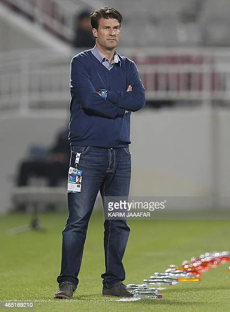 Qatar club Lekhwiya's head coach Michael Laudrup of Denmark looks on during his AFC Champions League Group A football match against Saudi Arabia's...