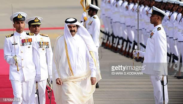 Qatar Emir Sheikh Hamad bin Khalifa alThani inspects a guard of honour of Sri Lankan troops during a welcome ceremony at Sri Lanka's international...