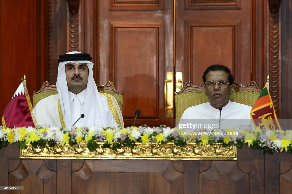 Qatar Emir Sheikh Tamim bin Hamad Al-Thani (L) and Sri Lankan President <a gi-track='captionPersonalityLinkClicked' href=/galleries/search?phrase=Maithripala+Sirisena&family=editorial&specificpeople=3102975 ng-click='$event.stopPropagation()'>Maithripala Sirisena</a> look on during a meeting at the Presidential Secretariat in Colombo on March 24, 2015. The Emir of Qatar is on a one-day state visit to Sri Lanka.