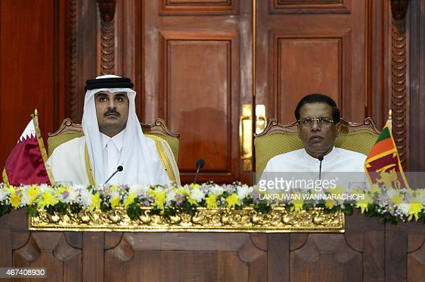 Qatar Emir Sheikh Tamim bin Hamad AlThani and Sri Lankan President Maithripala Sirisena look on during a meeting at the Presidential Secretariat in...