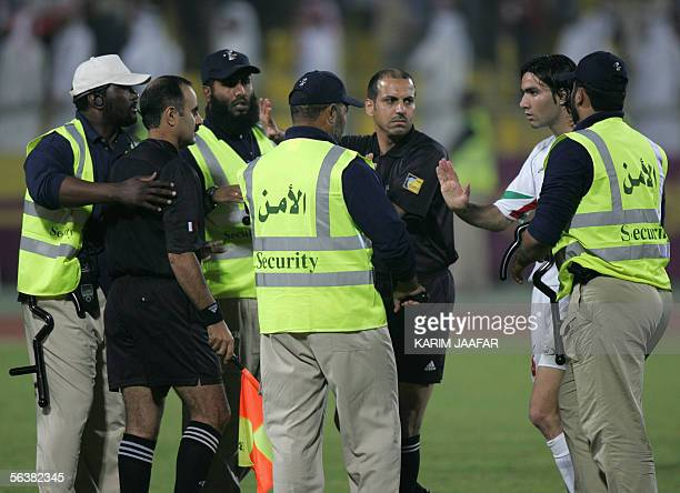 Iran national team captain Jvad Mikonam argues with a linesman during his team's semifinal match against Syria 08 December 2005 at the 3rd West Asian...