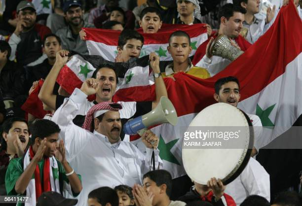 Iraqi fans cheers on their team against Syria during their football final for the gold 10 December 2005 at the West Asian Games in Doha The West...