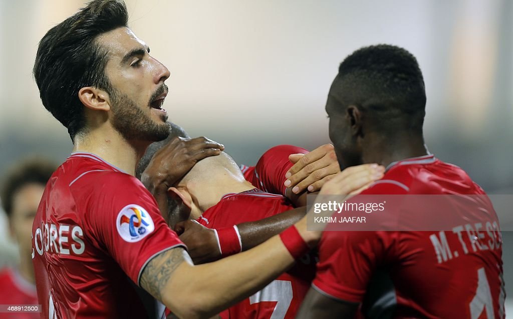 Qatar Lekhwiya's defender Chico Flores (L) congratulates his teammate <a gi-track='captionPersonalityLinkClicked' href=/galleries/search?phrase=Vladimir+Weiss+-+Soccer+Player&family=editorial&specificpeople=7035785 ng-click='$event.stopPropagation()'>Vladimir Weiss</a> (C) after scoring his teams goal against Uzbekistan Bunyodkor during their AFC Champions League group A football match on April 8, 2015, at the Abdullah bin Nasser bin Khalifa stadium in Doha.