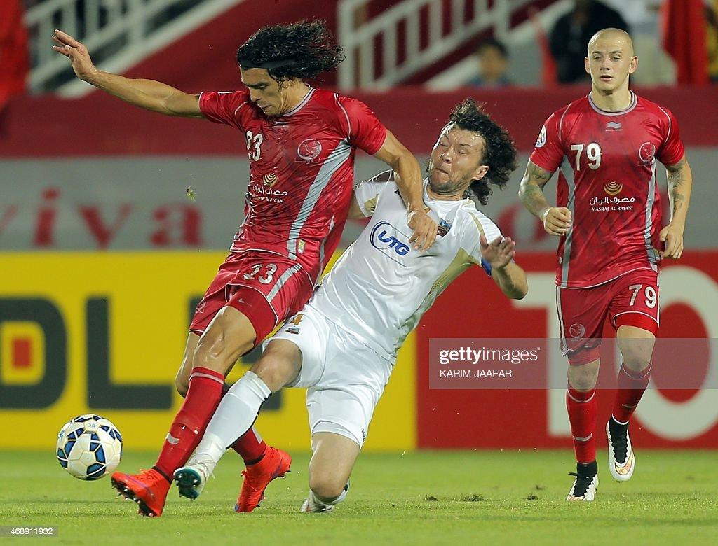 Qatar Lekhwiya's forward Sebastian Soria is challenged by Uzbekistan Bunyodkor's defender Hayrulla Karimov during their AFC Champions League group A...