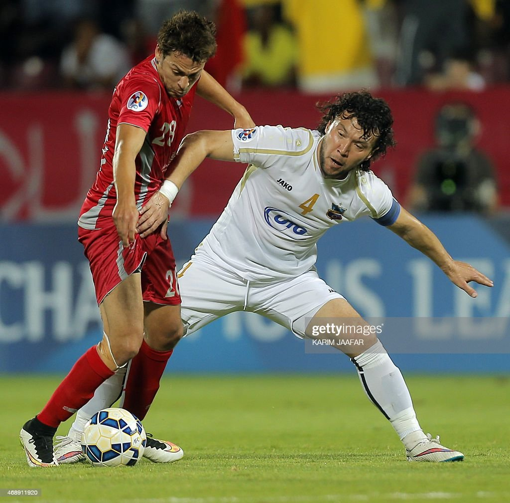 Qatar Lekhwiya's midfielder <a gi-track='captionPersonalityLinkClicked' href=/galleries/search?phrase=Youssef+Msakni&family=editorial&specificpeople=5672735 ng-click='$event.stopPropagation()'>Youssef Msakni</a> (L) is challenged by Uzbekistan Bunyodkor's defender Hayrulla Karimov (R) during their AFC Champions League group A football match on April 8, 2015, at the Abdullah bin Nasser bin Khalifa stadium in Doha.