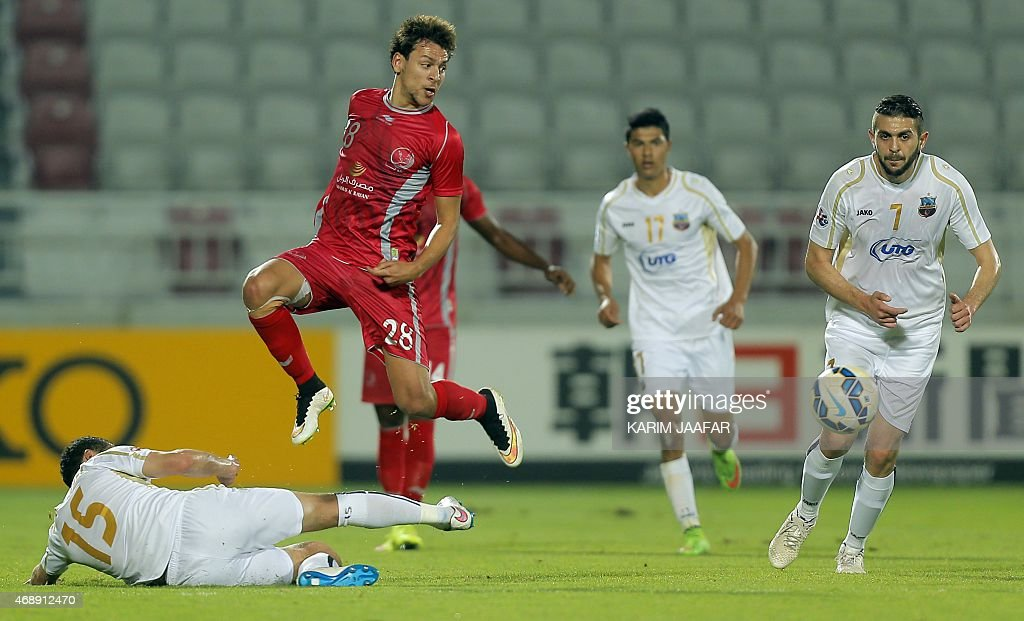 Qatar Lekhwiya's midfielder <a gi-track='captionPersonalityLinkClicked' href=/galleries/search?phrase=Youssef+Msakni&family=editorial&specificpeople=5672735 ng-click='$event.stopPropagation()'>Youssef Msakni</a> (L, red) is challenged by Uzbekistan Bunyodkor's defender Obid Jurabaev (L, bottom) during their AFC Champions League group A football match on April 8, 2015, at the Abdullah bin Nasser bin Khalifa stadium in Doha.