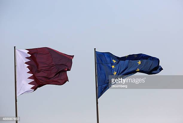 A Qatar national flag left flies beside the European Union flag outside the Chancellery in Berlin Germany on Wednesday Sept 17 2014 Qatar yesterday...