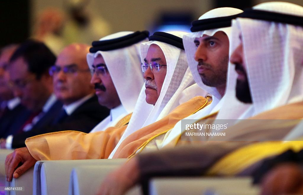 Qatar Oil Minister Mohammed bin Saleh Al-Sada, Saudi Oil Minister Ali al-Naimi, United Arab Emirates Energy Minister Suhail bin Mohamed al-Mazroui and Kuwaiti Oil Minister Ali Saleh al-Omair (R) attend the opening session of the 10th Arab Energy Conference in Abu Dhabi, on December 21, 2014. 'Irresponsible' levels of output by producers from outside the OPEC oil cartel is among the main causes of the slump in prices, the United Arab Emirates energy minister told the energy forum. AFP PHOTO/MARWAN NAAMANI