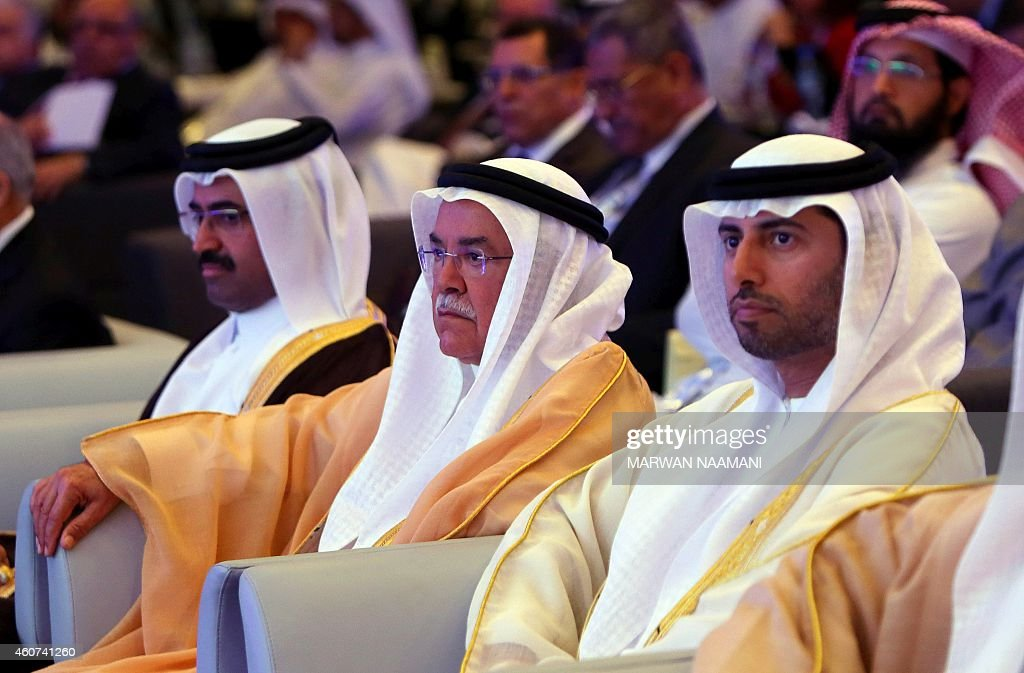 Qatar Oil Minister Mohammed bin Saleh Al-Sada (L), Saudi Oil Minister Ali al-Naimi, and United Arab Emirates Energy Minister Suhail bin Mohamed al-Mazroui (R) attend the opening session of the 10th Arab Energy Conference in Abu Dhabi, on December 21, 2014. 'Irresponsible' levels of output by producers from outside the OPEC oil cartel is among the main causes of the slump in prices, the United Arab Emirates energy minister told the energy forum. AFP PHOTO/MARWAN NAAMANI