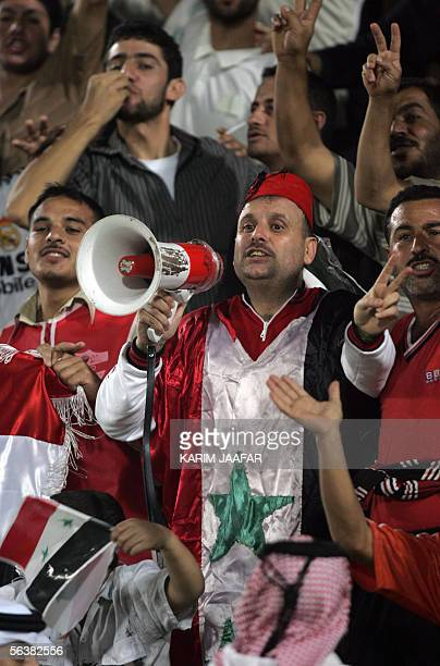 Syrian fans cheer their team on to victory against Iran in their semifinal football match 08 December 2005 at the 3rd West Asian Games in Doha Syria...