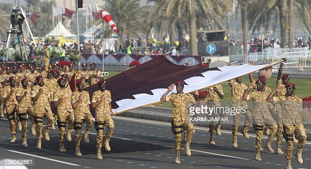 Qatari army forces take part in a military parade during the Gulf emirate's National Day celebrations in Doha on December 18 2011 AFP PHOTO/KARIM...