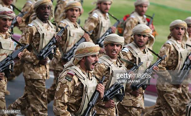 Qatari army forces take part in a military parade during the Gulf emirate's National Day celebrations in Doha on December 18 2012 AFP PHOTO / KARIM...