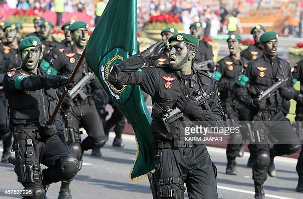 Qatari army forces take part in a military parade during the Gulf emirate's National Day celebrations in Doha on December 18 2013 AFP PHOTO / KARIM...