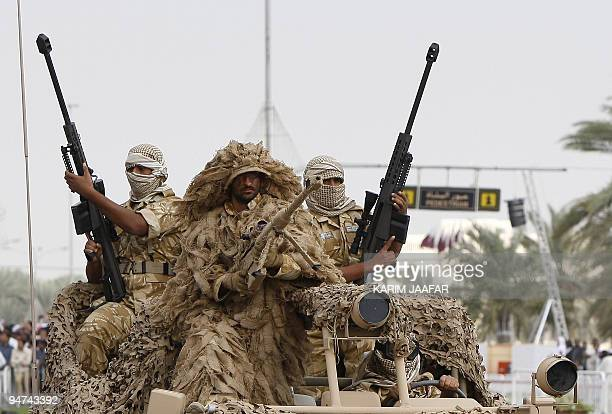 Qatari army forces take part in a military parade during the Gulf emirate's National Day celebrations in Doha on December 18 2009 AFP PHOTO/KARIM...
