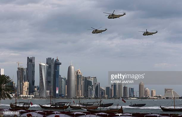 Qatari army helicopters take part in the military parade marking the Gulf emirate's National Day celebrations in Doha on December 18 2012 AFP PHOTO /...