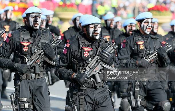 Qatari army special forces forces take part in a military parade during the Gulf emirate's National Day celebrations in Doha on December 18 2013 AFP...