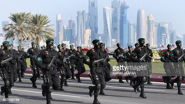 Qatari army special forces take part in a military parade during the Gulf emirate's National Day celebrations in Doha on December 18 2013 AFP PHOTO /...