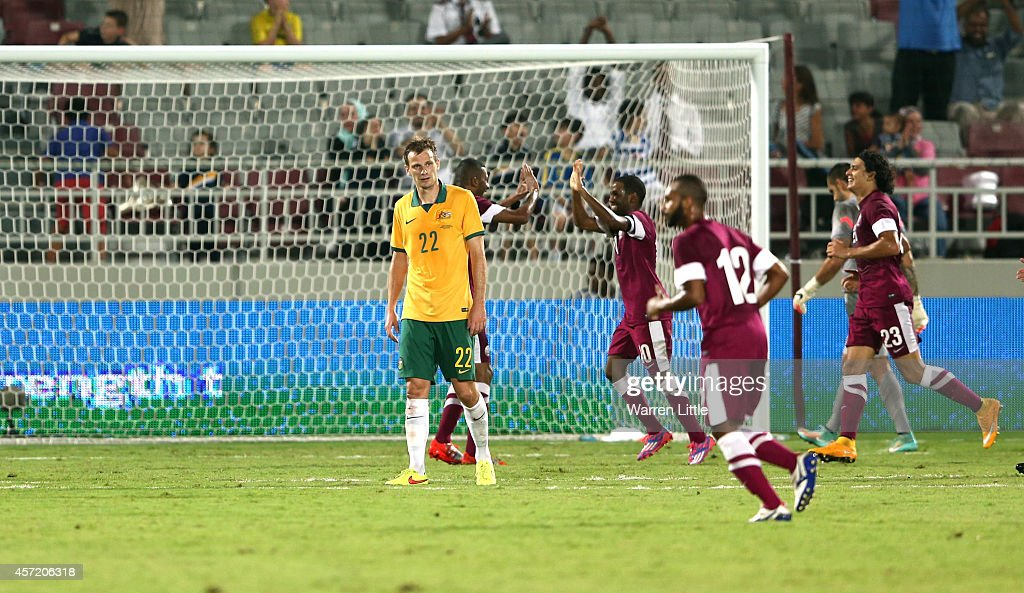 Qatari Captain, Khalfan Ibrahim is congratulated after scorin g a goal during an international friendly match between Qatar and Australia at the Abdullah Bin Khalifa Stadium Stadium at on October 14, 2014 in Doha, Qatar.
