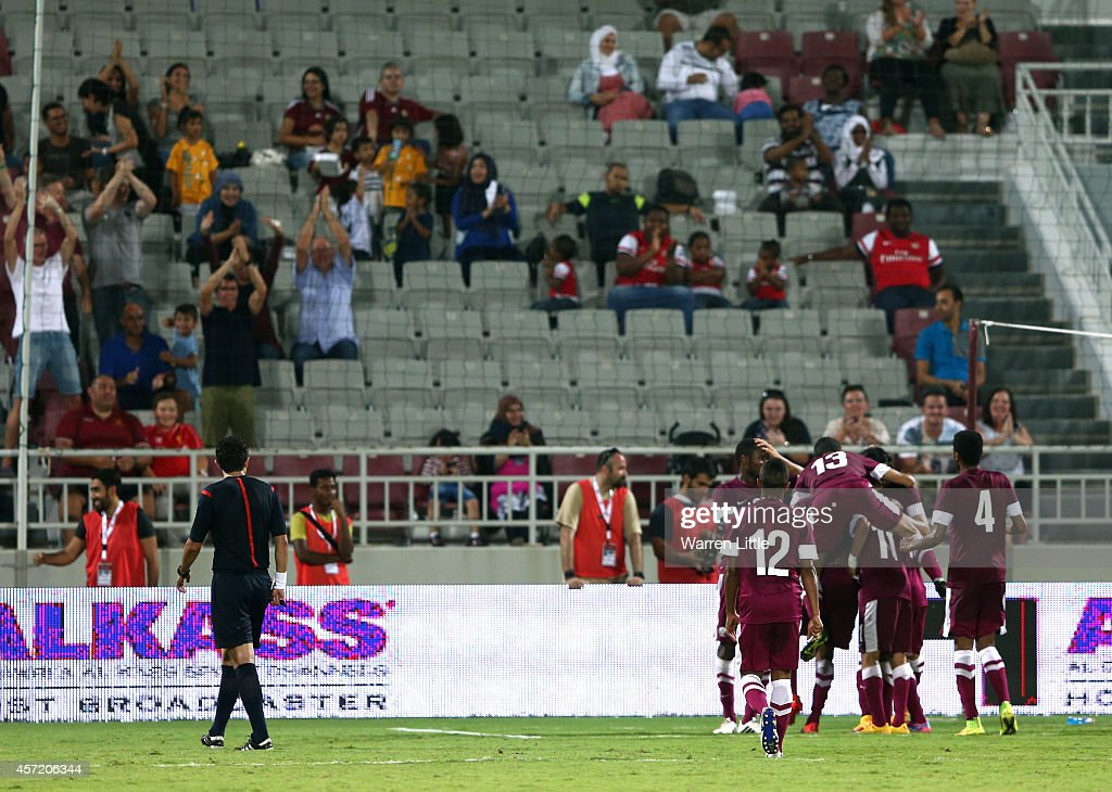 Qatari Captain, Khalfan Ibrahim is congratulated after scoring a goal during an international friendly match between Qatar and Australia at the Abdullah Bin Khalifa Stadium Stadium at on October 14, 2014 in Doha, Qatar.