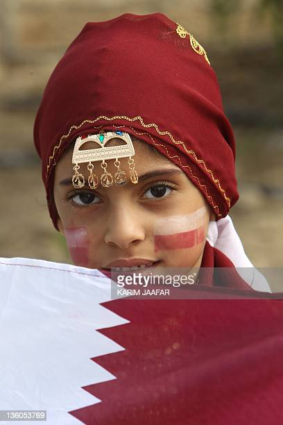 A Qatari child poses at a military parade during the Gulf emirate's National Day celebrations in Doha on December 18 2011 AFP PHOTO/KARIM JAAFAR