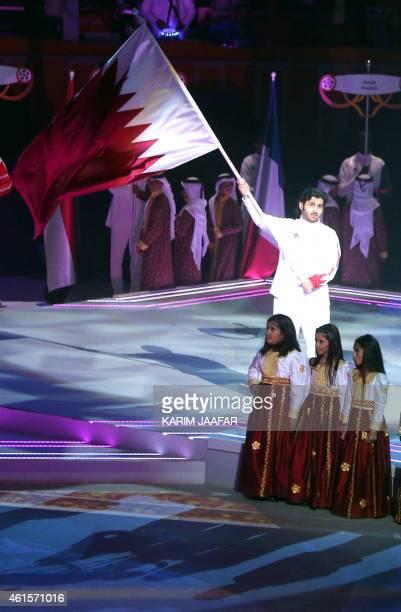 Qatari children perform in front of their national flag during the 24th Men's Handball World Championships opening ceremony at the Lusail...