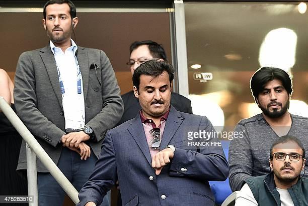 Qatari Crown Prince and ParisSaintGermains owner Tamim bin Hamad AlThani reacts during the French Cup final football match between Paris SaintGermain...