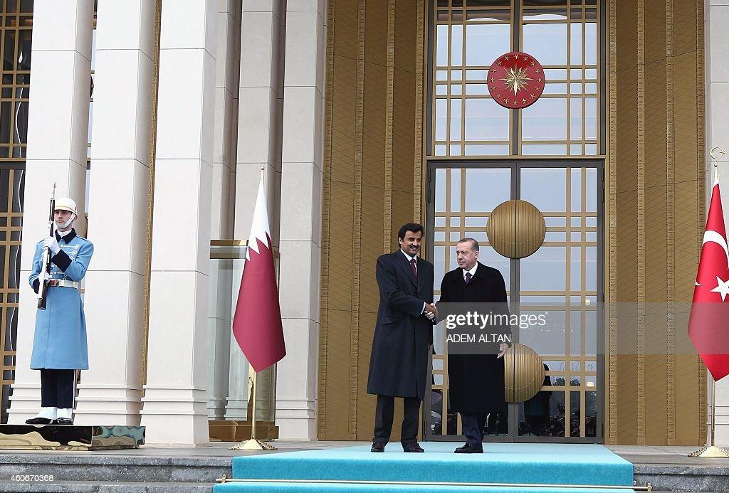 Qatari Crown Prince Sheikh Tamim bin Hamad bin Khalifa alThani is welcomed by Turkish President Recep Tayyip Erdogan prior to a meeting at the...
