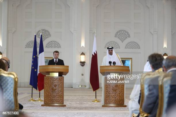 Qatari Emir Sheikh Tamim bin Hamad alThani and French President Emmanuel Macron give a press conference following the signing of agreements in Doha...
