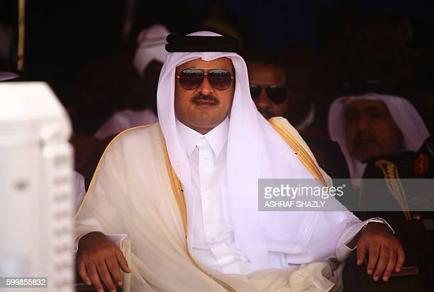 Qatari emir Sheikh Tamim bin Hamad alThani attends a ceremony to declare an end to 13 years of conflict in Darfur on September 7 2016 in the North...