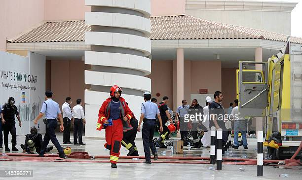 Qatari firefighters and rescue teams rush to Doha's Villagio Mall after a fire broke out at the Gulf emirate's main shopping centre on May 28 killing...