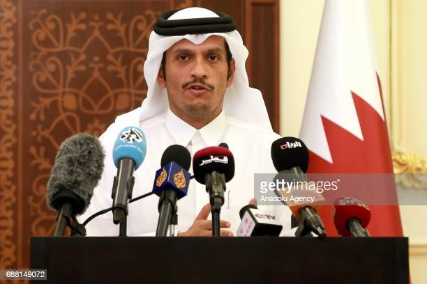 Qatari Foreign Minister Jassim AlThani speaks during a joint press conference with Somalian Foreign Minister Garaad Omar in Doha Qatar on May 25 2017