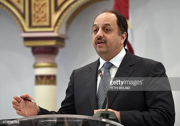 Qatari Foreign Minister Khalid bin Mohamed alAttiyah gives a press conference following his meeting with his Tunisian counterpart Taieb Baccouche in...
