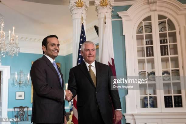 Qatari Foreign Minister Sheikh Mohammed Bin Abdulrahman Al Thani and US Secretary of State Rex Tillerson shake hands during a brief media...