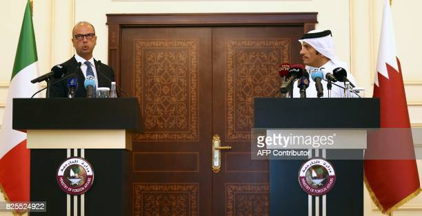 Qatari Foreign Minister Sheikh Mohammed bin Abdulrahman AlThani and his Italian counterpart Angelino Alfano speak during a press conference in Doha...